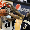 """University of Colorado's Josh Scott fights towards the basket through a swarm of defenders including John Swinton, No. 3, during a game against the Wofford Terriers on Friday, Nov. 9, at the Coors Event Center on the CU campus in Boulder. For more photos of the game go to  <a href=""""http://www.dailycamera.com"""">http://www.dailycamera.com</a><br /> Jeremy Papasso/ Camera"""