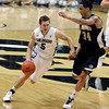 "University of Colorado's Eli Stalzer drives past Lee Skinner during a game against the Wofford Terriers on Friday, Nov. 9, at the Coors Event Center on the CU campus in Boulder. For more photos of the game go to  <a href=""http://www.dailycamera.com"">http://www.dailycamera.com</a><br /> Jeremy Papasso/ Camera"