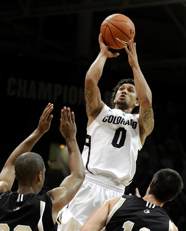 "University of Colorado's Askia Booker takes a shot over a pack of Wofford defenders during a game against the Wofford Terriers on Friday, Nov. 9, at the Coors Event Center on the CU campus in Boulder. For more photos of the game go to  <a href=""http://www.dailycamera.com"">http://www.dailycamera.com</a><br /> Jeremy Papasso/ Camera"
