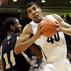"University of Colorado's Josh Scott spins past Aerris Smith toward the basket during a game against the Wofford Terriers on Friday, Nov. 9, at the Coors Event Center on the CU campus in Boulder. For more photos of the game go to  <a href=""http://www.dailycamera.com"">http://www.dailycamera.com</a><br /> Jeremy Papasso/ Camera"