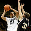 "University of Colorado's dAndre Roberson takes a shot over C.J. Neumann during a game against the Wofford Terriers on Friday, Nov. 9, at the Coors Event Center on the CU campus in Boulder. For more photos of the game go to  <a href=""http://www.dailycamera.com"">http://www.dailycamera.com</a><br /> Jeremy Papasso/ Camera"