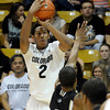 "University of Colorado's Xavier Johnson takes a shot over Jarell Byrd during a game against the Wofford Terriers on Friday, Nov. 9, at the Coors Event Center on the CU campus in Boulder. For more photos of the game go to  <a href=""http://www.dailycamera.com"">http://www.dailycamera.com</a><br /> Jeremy Papasso/ Camera"
