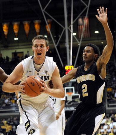 """University of Colorado's Shane Harris-Tunks drives to the hoop past Karl Cochran during a game against the Wofford Terriers on Friday, Nov. 9, at the Coors Event Center on the CU campus in Boulder. For more photos of the game go to  <a href=""""http://www.dailycamera.com"""">http://www.dailycamera.com</a><br /> Jeremy Papasso/ Camera"""