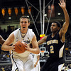 "University of Colorado's Shane Harris-Tunks drives to the hoop past Karl Cochran during a game against the Wofford Terriers on Friday, Nov. 9, at the Coors Event Center on the CU campus in Boulder. For more photos of the game go to  <a href=""http://www.dailycamera.com"">http://www.dailycamera.com</a><br /> Jeremy Papasso/ Camera"