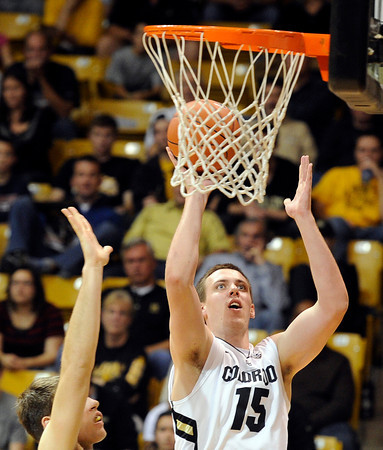 "University of Colorado's Shane Harris-Tunks takes a shot during a game against the Wofford Terriers on Friday, Nov. 9, at the Coors Event Center on the CU campus in Boulder. For more photos of the game go to  <a href=""http://www.dailycamera.com"">http://www.dailycamera.com</a><br /> Jeremy Papasso/ Camera"