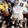 Colorado guard Askia Booker, left, collides with Arizona State center Jordan Bachynski, right, in the first half of an NCAA college basketball game Saturday, Feb. 11, 2012, in Tempe, Ariz. Bachynski was called for a blocking foul on the play.(AP Photo/Paul Connors)