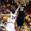 Colorado guard Carlon Brown, right, attempts a field goal over Arizona State guard Trent Lockett, left, in the first half of an NCAA college basketball game on Saturday, Feb. 11, 2012, in Tempe, Ariz. (AP Photo/Paul Connors)