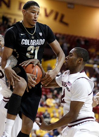 Colorado forward Andre Roberson, left, grabs a rebound in front of Arizona State guard Chris Colvin, right, in the second half of an NCAA college basketball game on Saturday, Feb. 11, 2012, in Tempe, Ariz. Colorado won 63-49. (AP Photo/Paul Connors)