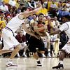 Colorado guard Askia Booker, center, drives to the basket between Arizona State center Ruslan Pateev, left, of Russia, and Carrick Felix, right, in the first half of an NCAA college basketball game Saturday, Feb. 11, 2012, in Tempe, Ariz. (AP Photo/Paul Connors)
