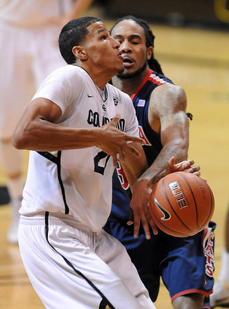 Jesse Perry of Arizona knocks the ball away from Andre Roberson of Colorado during the second half of the January 21, 2012 game in Boulder.<br /> January 21, 2012 / Cliff Grassmick