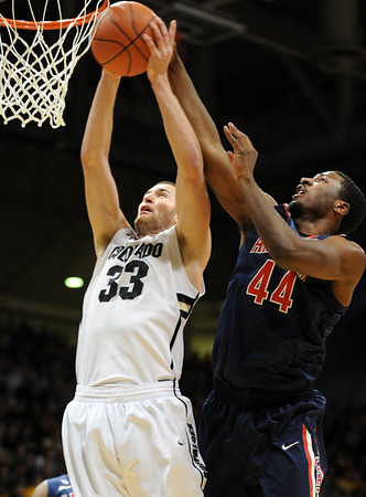 "Austin Dufault of Colorado is fouled on a dunk attempt by Solomon Hill of Arizona during the first half of the January 21, 2012 game in Boulder.<br /> For more photos of the game, go to  <a href=""http://www.dailycamera.com"">http://www.dailycamera.com</a>.<br /> January 21, 2012 / Cliff Grassmick"