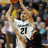 "Andre Roberson of CU shoots over Jesse Perry of Arizona<br /> during the second half of the January 21, 2012 game in Boulder.<br /> For more photos of the game, go to  <a href=""http://www.dailycamera.com"">http://www.dailycamera.com</a>.<br /> January 21, 2012 / Cliff Grassmick"