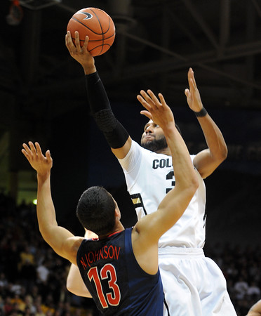 "Carlon Brown of Colorado drives to the basket against Nick Johnson of Arizona during the first half of the January 21, 2012 game in Boulder.<br /> For more photos of the game, go to  <a href=""http://www.dailycamera.com"">http://www.dailycamera.com</a>.<br /> January 21, 2012 / Cliff Grassmick"