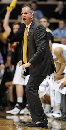 "CU coach Tad Boyle shows his intensity during the first half of the January 21, 2012  Arizona game in Boulder.<br /> For more photos of the game, go to  <a href=""http://www.dailycamera.com"">http://www.dailycamera.com</a>.<br /> January 21, 2012 / Cliff Grassmick"