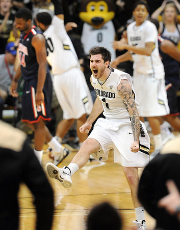 "Nate Tomlinson (1) of CU, celebrates the 1-point win over Arizona on Saturday.<br /> For more photos of the game, go to  <a href=""http://www.dailycamera.com"">http://www.dailycamera.com</a>.<br /> January 21, 2012 / Cliff Grassmick"