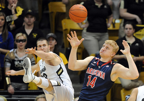 "Austin Dufault, left,  of Colorado, and Kyryl Natyazhko of Arizona, struggle for possession during the second half of the January 21, 2012 game in Boulder.<br /> For more photos of the game, go to  <a href=""http://www.dailycamera.com"">http://www.dailycamera.com</a>.<br /> January 21, 2012 / Cliff Grassmick"