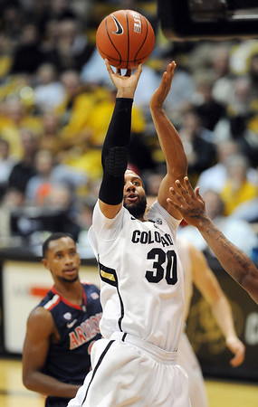 "Carlon Brown of CU takes a jumper against Arizona<br /> during the second half of the January 21, 2012 game in Boulder.<br /> For more photos of the game, go to  <a href=""http://www.dailycamera.com"">http://www.dailycamera.com</a>.<br /> January 21, 2012 / Cliff Grassmick"