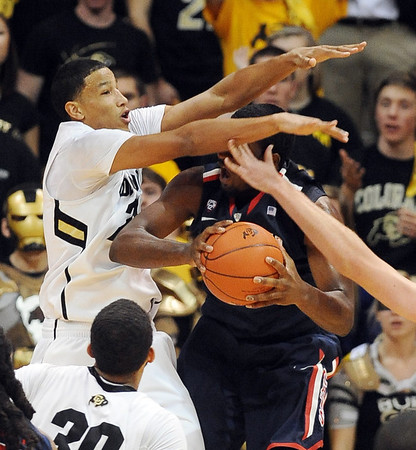 """Andre Roberson, left,  of CU, puts the clamps on Solomon Hill of Arizona<br /> during the second half of the January 21, 2012 game in Boulder.<br /> For more photos of the game, go to  <a href=""""http://www.dailycamera.com"""">http://www.dailycamera.com</a>.<br /> January 21, 2012 / Cliff Grassmick"""