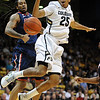 "Spencer Dinwiddie (25) of Colorado, has the ball knocked away by Jesse Perry, left,  of Arizona during the first half of the January 21, 2012 game in Boulder.<br /> For more photos of the game, go to  <a href=""http://www.dailycamera.com"">http://www.dailycamera.com</a>.<br /> January 21, 2012 / Cliff Grassmick"