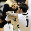 "Carlon Brown of CU gets a hug from Nate Tomlinson after the 1-point win over Arizona on Saturday.<br /> For more photos of the game, go to  <a href=""http://www.dailycamera.com"">http://www.dailycamera.com</a>.<br /> January 21, 2012 / Cliff Grassmick"
