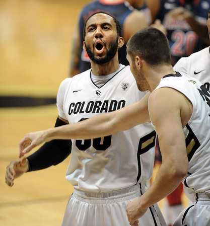 "Carlon Brown of Colorado is excited about the basket and foul for Austin Dufault, right, late in the Arizona game.<br /> <br /> For more photos of the game, go to  <a href=""http://www.dailycamera.com"">http://www.dailycamera.com</a>.<br /> January 21, 2012 / Cliff Grassmick"