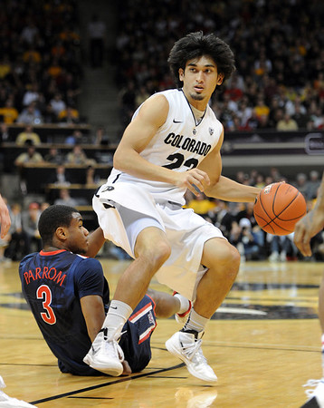 """Sabatino Chen of CU gets around Kevin Parrom of Arizona during the first half of the January 21, 2012 game in Boulder.<br /> For more photos of the game, go to  <a href=""""http://www.dailycamera.com"""">http://www.dailycamera.com</a>.<br /> January 21, 2012 / Cliff Grassmick"""