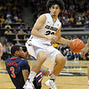 "Sabatino Chen of CU gets around Kevin Parrom of Arizona during the first half of the January 21, 2012 game in Boulder.<br /> For more photos of the game, go to  <a href=""http://www.dailycamera.com"">http://www.dailycamera.com</a>.<br /> January 21, 2012 / Cliff Grassmick"