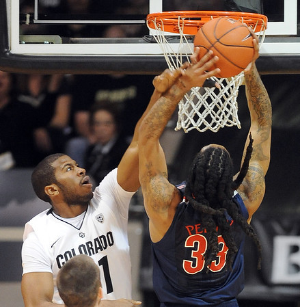 "Jeremy Adams of Colorado fouls Jesse Perry of Arizona on a dunk attempt during the first half of the January 21, 2012 game in Boulder.<br /> For more photos of the game, go to  <a href=""http://www.dailycamera.com"">http://www.dailycamera.com</a>.<br /> January 21, 2012 / Cliff Grassmick"