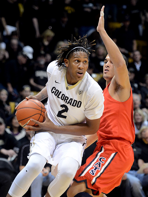 . Xavier Johnson of CU drives around Nick Johnson of Arizona during the first half of the February 22, 2014 game in Boulder, Colo.  Cliff Grassmick / February 22, 2014
