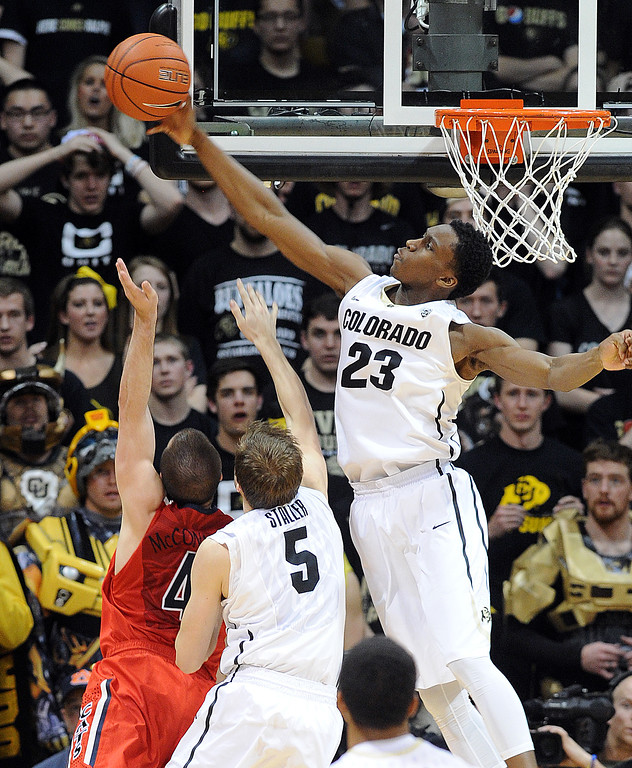 . Jaron Hopkins of CU blocks the shot of TJ McConnell of Arizona during the second half of the February 22, 2014 game in Boulder, Colo.  Cliff Grassmick / February 22, 2014