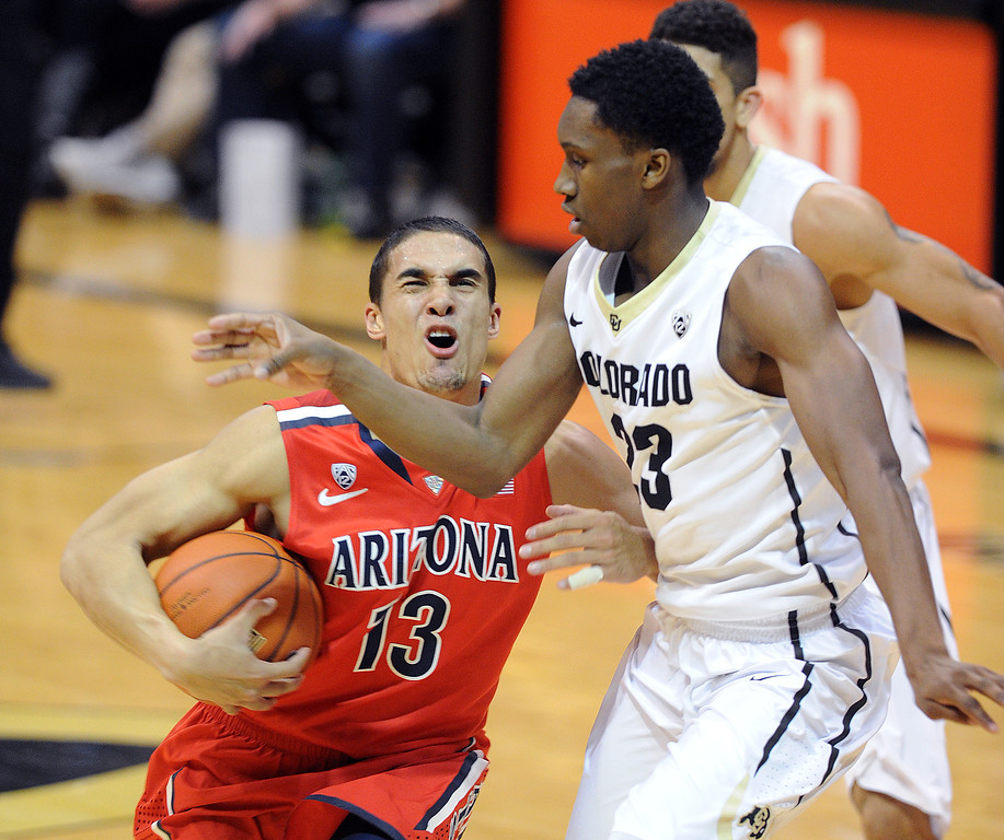 . Jaron Hopkins, right, of CU, gets physical on Nick Johnson of Arizona during the second half of the February 22, 2014 game in Boulder, Colo.  Cliff Grassmick / February 22, 2014