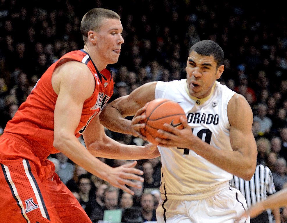 . Josh Scott of CU tries to muscle Kaleb Tarczewski of Arizona during the first half of the February 22, 2014 game in Boulder, Colo.  Cliff Grassmick / February 22, 2014