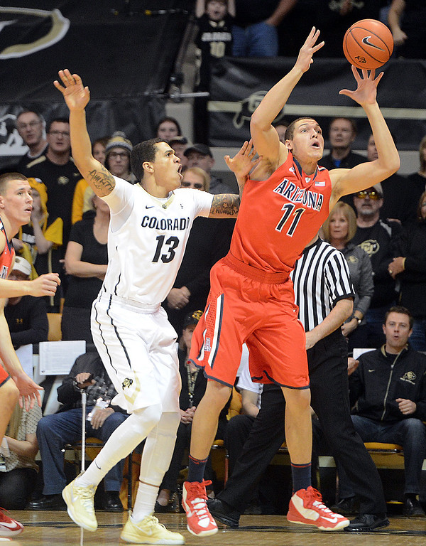. aaron Gordon of Arizona gets a pass in front of Dustin Thomas of CU during the first half of the February 22, 2014 game in Boulder, Colo.  Cliff Grassmick / February 22, 2014