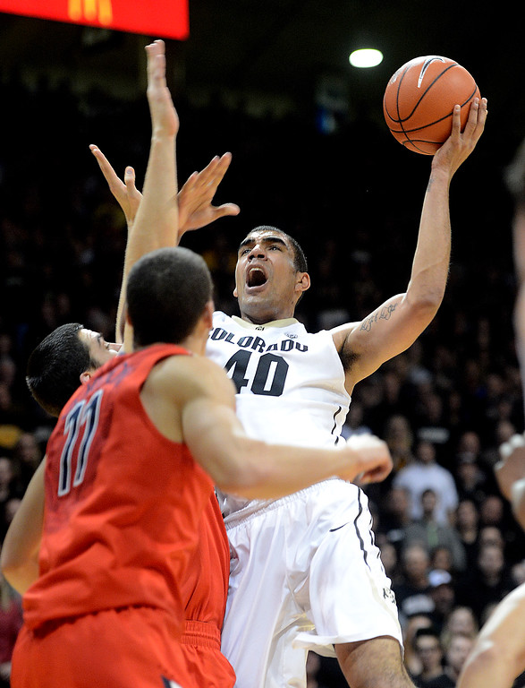 . Josh Scott tries to score against Arizona during the first half of the February 22, 2014 game in Boulder, Colo.  Cliff Grassmick / February 22, 2014