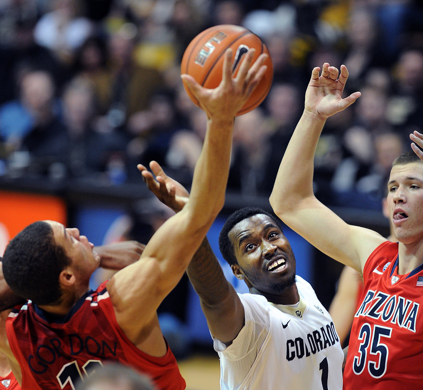 . Aaron Gordon, left, of Arizona, and Wesley Gordon of CU battle under the board during the second half of the February 22, 2014 game in Boulder, Colo.  Cliff Grassmick / February 22, 2014
