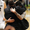 "Tad Boyle has a big hug for senior Nate Tomlinson at the end<br />  of the February 26, 2012 game in Boulder.<br /> For more photos of the game, go to  <a href=""http://www.dailycamera.com"">http://www.dailycamera.com</a>.<br /> February 26, 2012 / Cliff Grassmick"