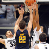 """Austin Dufault, left, and Andre Roberson, both of CU, defend Harper Kamp of Cal during the first half of the February 26, 2012 game in Boulder.<br /> For more photos of the game, go to  <a href=""""http://www.dailycamera.com"""">http://www.dailycamera.com</a>.<br /> February 26, 2012 / Cliff Grassmick"""