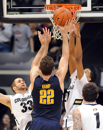 "Austin Dufault, left, and Andre Roberson, both of CU, defend Harper Kamp of Cal during the first half of the February 26, 2012 game in Boulder.<br /> For more photos of the game, go to  <a href=""http://www.dailycamera.com"">http://www.dailycamera.com</a>.<br /> February 26, 2012 / Cliff Grassmick"