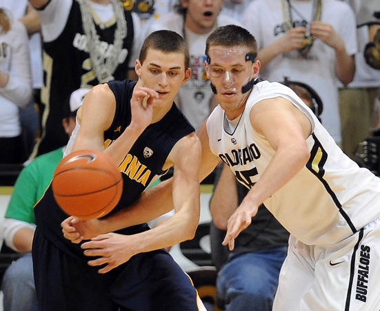 "David Kravish, left, of Cal, and Shane Harris-Tunks of CU go for the ball during the second half of the February 26, 2012 game in Boulder.<br /> For more photos of the game, go to  <a href=""http://www.dailycamera.com"">http://www.dailycamera.com</a>.<br /> February 26, 2012 / Cliff Grassmick"
