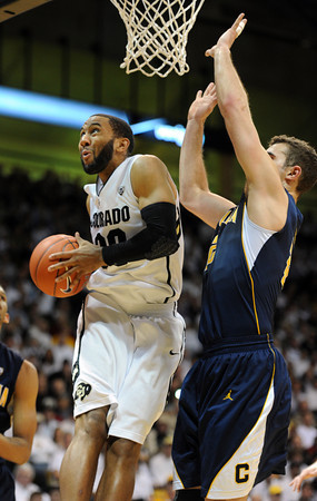 "Carlon Brown does a spin move on Harper Kamp of Cal<br /> during the first half of the February 26, 2012 game in Boulder.<br /> For more photos of the game, go to  <a href=""http://www.dailycamera.com"">http://www.dailycamera.com</a>.<br /> February 26, 2012 / Cliff Grassmick"