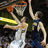 """Austin Dufault of CU puts in the layup past David Kravish of Cal<br /> during the first half of the February 26, 2012 game in Boulder.<br /> For more photos of the game, go to  <a href=""""http://www.dailycamera.com"""">http://www.dailycamera.com</a>.<br /> February 26, 2012 / Cliff Grassmick"""