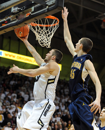 "Austin Dufault of CU puts in the layup past David Kravish of Cal<br /> during the first half of the February 26, 2012 game in Boulder.<br /> For more photos of the game, go to  <a href=""http://www.dailycamera.com"">http://www.dailycamera.com</a>.<br /> February 26, 2012 / Cliff Grassmick"