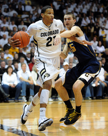 "Andre Roberson of CU gets arond David Kravish of Cal<br /> during the first half of the February 26, 2012 game in Boulder.<br /> For more photos of the game, go to  <a href=""http://www.dailycamera.com"">http://www.dailycamera.com</a>.<br /> February 26, 2012 / Cliff Grassmick"