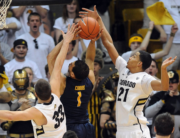 "Austin Dufault, left, and Andre Roberson of CU, shut down the shot of Justin Cobbs of Cal during the second half of the February 26, 2012 game in Boulder.<br /> For more photos of the game, go to  <a href=""http://www.dailycamera.com"">http://www.dailycamera.com</a>.<br /> February 26, 2012 / Cliff Grassmick"