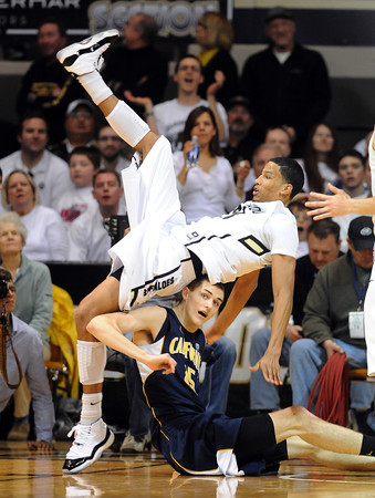 "Andre Roberson of CU falls over David Kravish of Cal<br /> during the first half of the February 26, 2012 game in Boulder.<br /> For more photos of the game, go to  <a href=""http://www.dailycamera.com"">http://www.dailycamera.com</a>.<br /> February 26, 2012 / Cliff Grassmick"