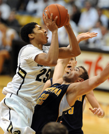 "Spencer Dinwiddie of CU drives on Harper Kamp of Cal<br /> during the second half of the February 26, 2012 game in Boulder.<br /> For more photos of the game, go to  <a href=""http://www.dailycamera.com"">http://www.dailycamera.com</a>.<br /> February 26, 2012 / Cliff Grassmick"