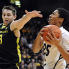 "Spencer Diwiddie of Colorado, drives past Garrett Sim of Oregon<br /> during the first half of the February 4, 2012 game in Boulder.<br /> For more photos of the game, go to  <a href=""http://www.dailycamera.com"">http://www.dailycamera.com</a>.<br /> February 4, 2012 / Cliff Grassmick"