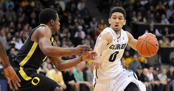 """Asia Booker of CU looks to drive on Oregon<br /> during the first half of the February 4, 2012 game in Boulder.<br /> For more photos of the game, go to  <a href=""""http://www.dailycamera.com"""">http://www.dailycamera.com</a>.<br /> February 4, 2012 / Cliff Grassmick"""