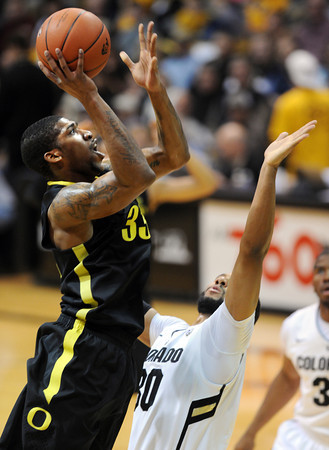 """Carlos Emery of Oregon, shoots over Carlon Brown of Colorado<br /> during the first half of the February 4, 2012 game in Boulder.<br /> For more photos of the game, go to  <a href=""""http://www.dailycamera.com"""">http://www.dailycamera.com</a>.<br /> February 4, 2012 / Cliff Grassmick"""
