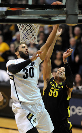 "Carlon Brown of Colorado scores a critical basket over Tony Woods of Oregon near the end  of the February 4, 2012 game in Boulder.<br /> For more photos of the game, go to  <a href=""http://www.dailycamera.com"">http://www.dailycamera.com</a>.<br /> February 4, 2012 / Cliff Grassmick"
